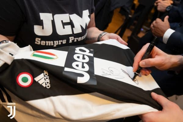 Juventus Player signing a jersey during one of the fan clubs' meet and greet.